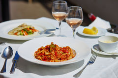 Seafood pasta with rose wine in the restaurant Stock Photo