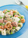 Seafood Pasta Spirals with Peas and Herbs Stock Photos