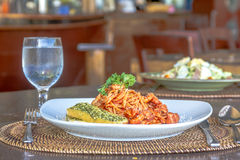 Seafood pasta in tomato sauce served in a small outdoor restaura Royalty Free Stock Photography
