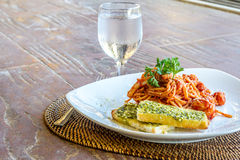 Seafood pasta in tomato sauce served in a small outdoor restaura Stock Photography