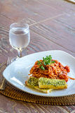 Seafood pasta in tomato sauce served in a small outdoor restaura Royalty Free Stock Photos