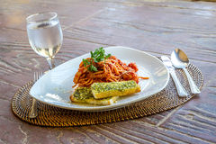Seafood pasta in tomato sauce served in a small outdoor restaura Royalty Free Stock Images