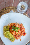 Seafood pasta in tomato sauce served in a small outdoor restaura Stock Photo