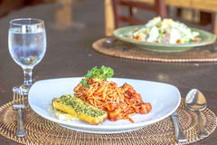 Seafood pasta in tomato sauce served in a small outdoor restaura Royalty Free Stock Photo