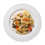 Seafood pasta on white plate isolated Royalty Free Stock Photography