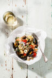 Seafood pasta and wine. Spaghetti with clams, prawns, sea scallops on white plate Royalty Free Stock Images
