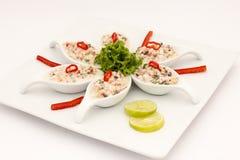 Seafood Peruvian dish: Pichanga de Mariscos. Ceviche style with white cream. Seafood Peruvian dish: Pichanga de Mariscos. Ceviche style with white cream Stock Image