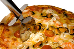 Seafood pizza and cutter Stock Photography