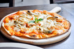Seafood pizza. Dish on the table Stock Photos