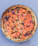 Seafood pizza with salmon fish. Delicious seafood pizza with salmon fish and pepper stock images