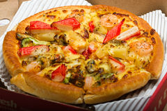 Seafood Pizza. Shot in the pizza box Royalty Free Stock Images