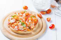 Seafood Pizza on wood plate Stock Image