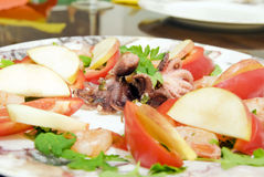 Seafood on plate. Octopus and shrimps with vegetables on plate Royalty Free Stock Photography