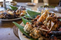 Seafood plate in bali indonesia served on banana leaf stock images