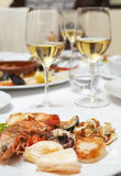 Seafood on plate in restaurant Stock Photo