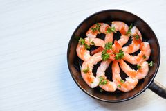 Seafood plate with shrimps prawns ocean gourmet decorate dinner table cooked with sauce herbs and spices on pan royalty free stock photo