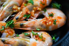 Seafood plate with shrimps prawns ocean gourmet dinner seafood cooked with sauce herbs and spices. On pan background / Close up shellfish shrimp boiled stock image