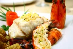 Seafood Platter. Fish fillet and prawns with garlic butter sauce stock images