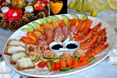 Seafood platter. Served fresh and deep fried surrounded with salad and bread Stock Photos