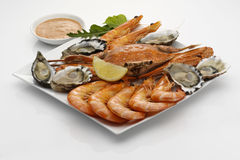 Seafood platter with dipping sauce. On white background stock photography