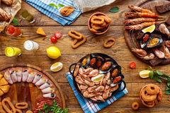 Seafood platter top view, flat lay on wooden table background Royalty Free Stock Image