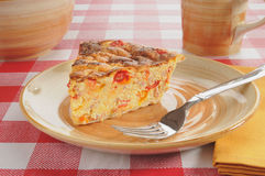 Seafood quiche. A plate of seafood quiche with coffee Royalty Free Stock Photos