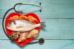 Seafood on red heart plate and stethoscope Stock Image