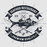 Seafood restaurant logo with fish and fishing rods. Vintage badge design. Vector illustration. vector illustration