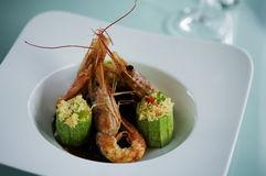 Seafood restaurant meal. Prawns and zucchini stuffed with couscous Royalty Free Stock Images