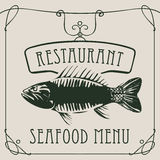 Seafood restaurant menu with big fish. Vector restaurant menu of seafood with a big fish in a retro style with a curly frame on beige background Stock Image