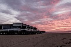 Seafood Restaurant on Pier at Sunrise. A restaurant built on a pier so that you are a part of the ocean during your dinning experience Royalty Free Stock Photos
