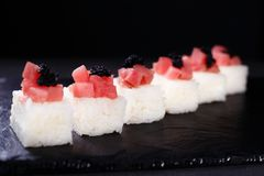 Seafood restaurant, pressed sushi with tuna. Seafood restaurant menu, pressed sushi with cream cheese, tuna and caviar, Japanese food art, delicacy, banquet stock photos