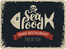 Seafood restaurants with fish and jolly roger Stock Photos