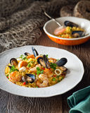 Seafood with Rice. A bowl of delicious seafood and rice with shrimp, scallops, mussels, and calamari rings Stock Photo
