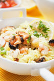 Seafood risotto. Cooked rice, risotto with mussels and shrimps Royalty Free Stock Image