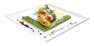 Seafood rolls with asparagus and vegetables stock photography