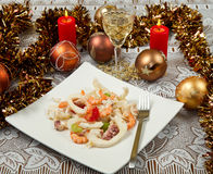 Seafood salad. On christmas table Stock Photography