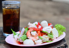 Seafood salad. With drink water Stock Images