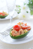 Seafood salad in avocado Royalty Free Stock Photos