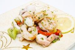 Seafood salad on decorated dish Stock Photo