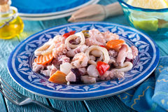 Seafood Salad. A delicious mixed seafood salad with octopus, calamari, shrimp, onions, red pepper, and carrot Royalty Free Stock Photography