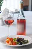 Seafood salad and a glass of rose wine. Stock Images