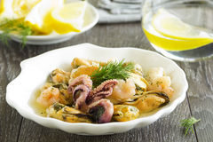 Seafood salad and lemon Stock Photography