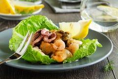 Seafood salad and lemon Royalty Free Stock Image