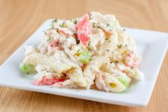 Seafood Salad. Seafood and pasta salad on a white plate Stock Images