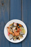 Seafood salad on plate on blue background Royalty Free Stock Photography
