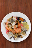 Seafood salad on plate on brown background Royalty Free Stock Photo