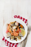 Seafood salad on plate on white background Stock Photos