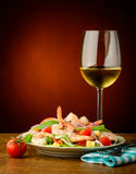 Seafood salad with prawns and wine. Still life with fresh and healthy seafood prawns salad and wine Stock Photography