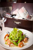 Seafood salad. And red wine in a restaurant Royalty Free Stock Photos